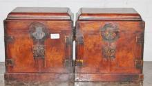 PAIR OF CHINESE HUANGHUALI BOOK-MATCHED TABLE-TOP CHESTS (GUANPIXIANG) of rectangular form with a bail handle on each side, the hinged domed cover set with brass mounts, opening to reveal a separate compartment above a pair of doors with ruyi-shaped bras