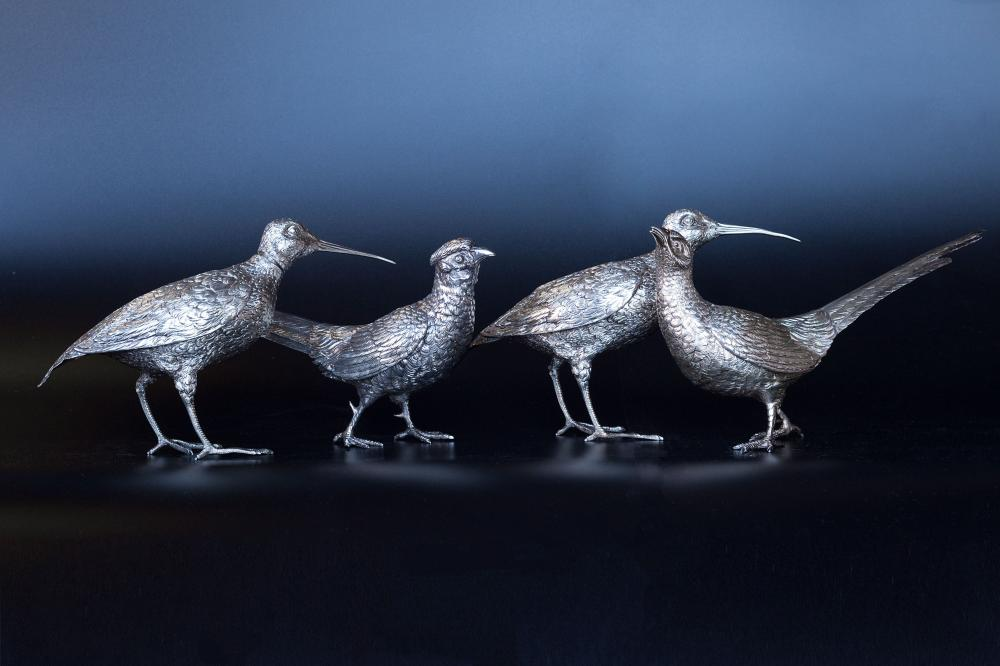 Set of French 19th century hallmarked silver decorative birds, consisting of two carafes and two decorative objects