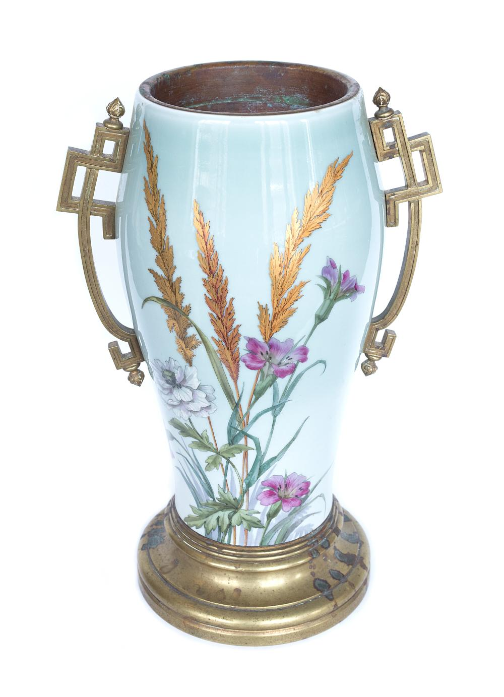 Imperial Porcelain Factory decorative vase with images of stylized flowers with bronze beams and base