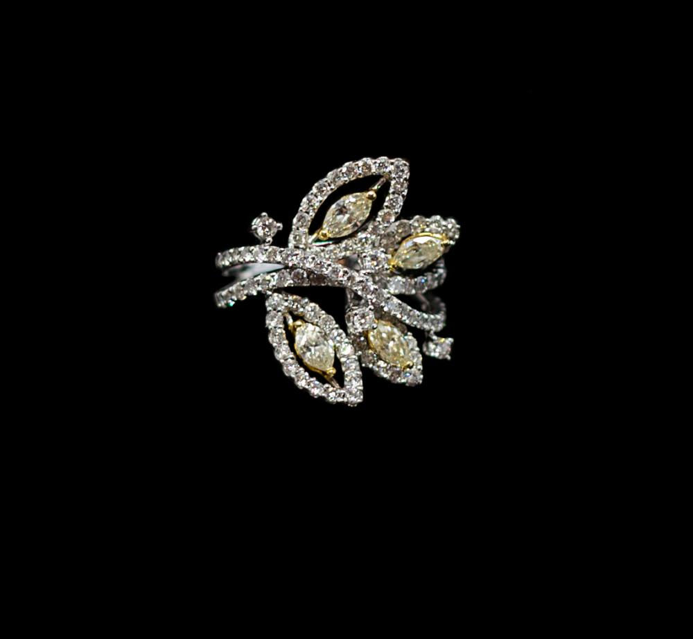2,15 CTW 18K white gold cluster design ring with  Fancy yellow and white diamonds.