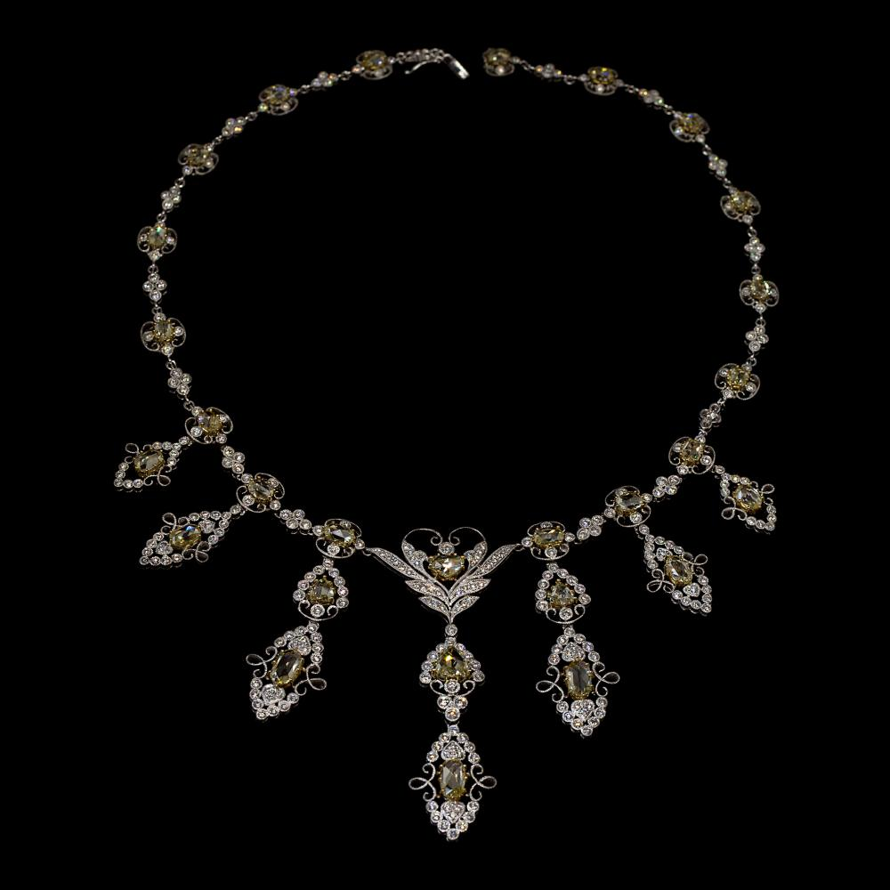12,89CTW 18K white gold necklace with fancy yellow diamonds.
