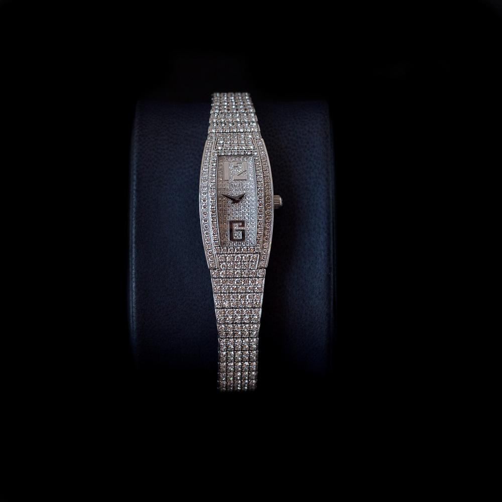 Piaget Limelight Tonneau white gold with pave set diamonds. This watch is also known as: G0A26054