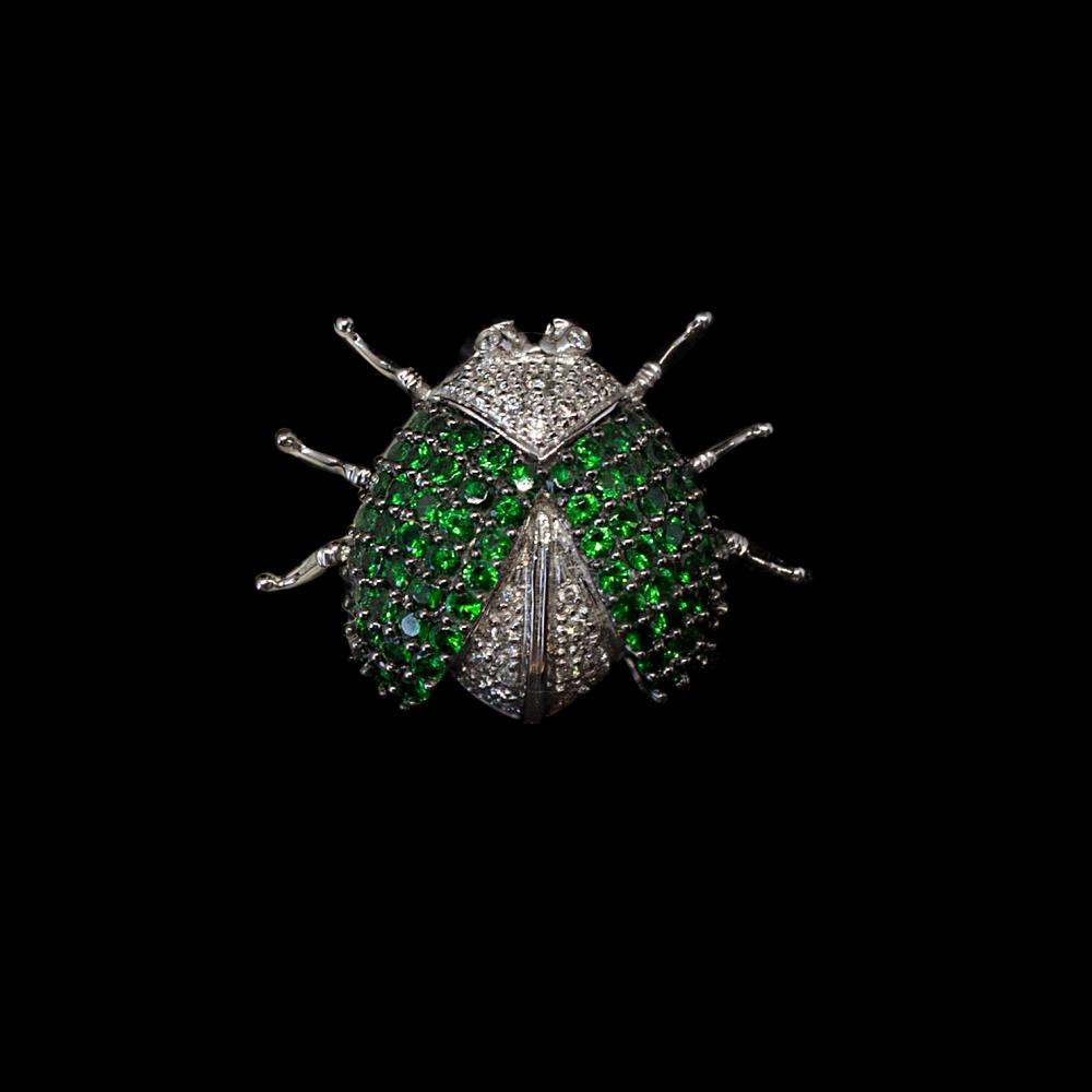 14K white gold Bug motif Pin/Brooch 2,99CTW green grenades and 0,20CTW diamonds.