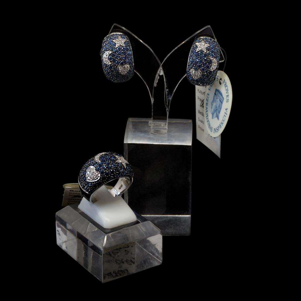18K white gold matching jewelry set with 8,18TCW blue sapphires and 0,51CTW diamonds.