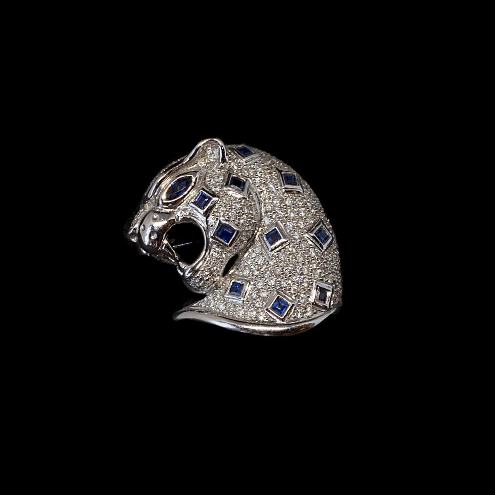 18K white gold Lepard motif Pin/Brooch 0,99CTW diamonds and 0,74CTW sapphires.