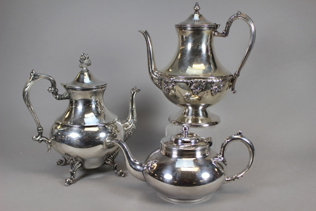 Lehman Brothers and Cooper Bros. Silverplate Teapots