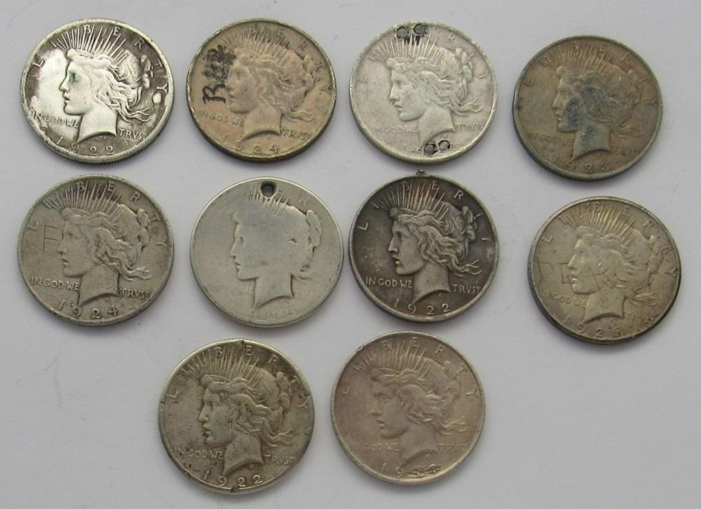 Lot 167: 10-Peace Silver Dollars damged or holed