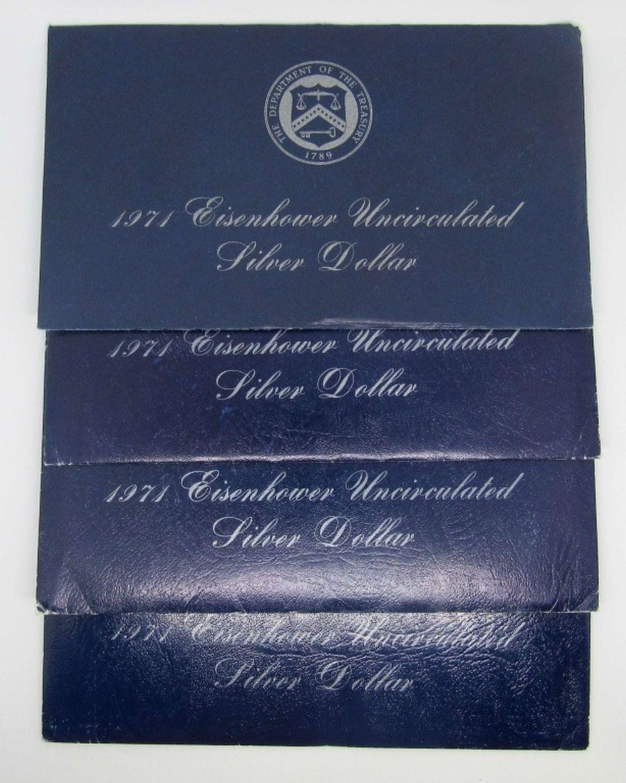 Lot 215: 4-1971 SILVER IKE DOLLARS UNC