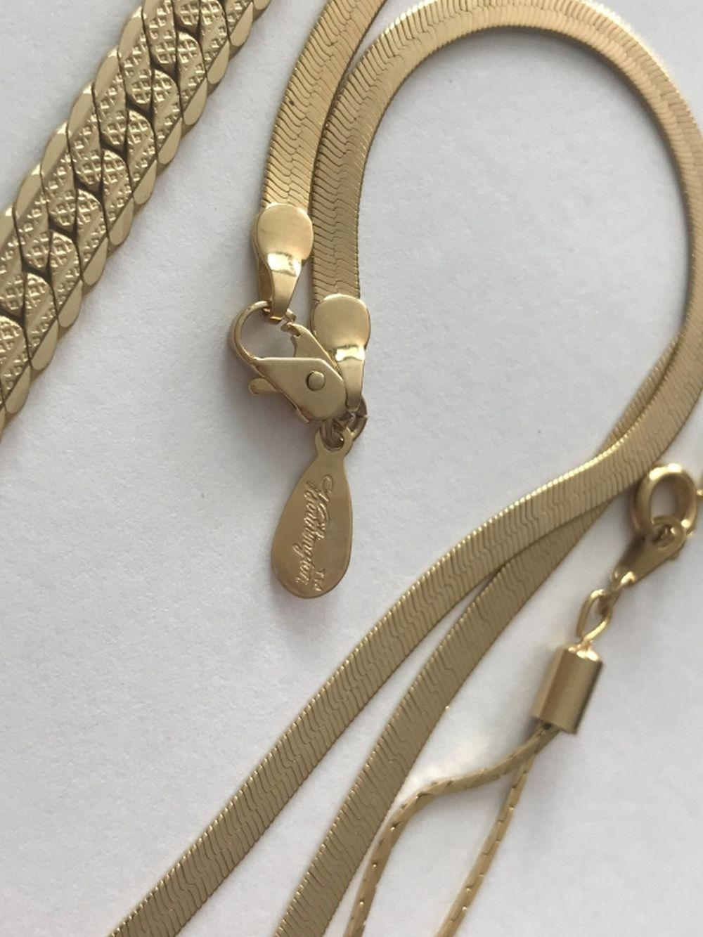 3 GOLD TONED NECKLACES (1 W/ MAKER MARK)