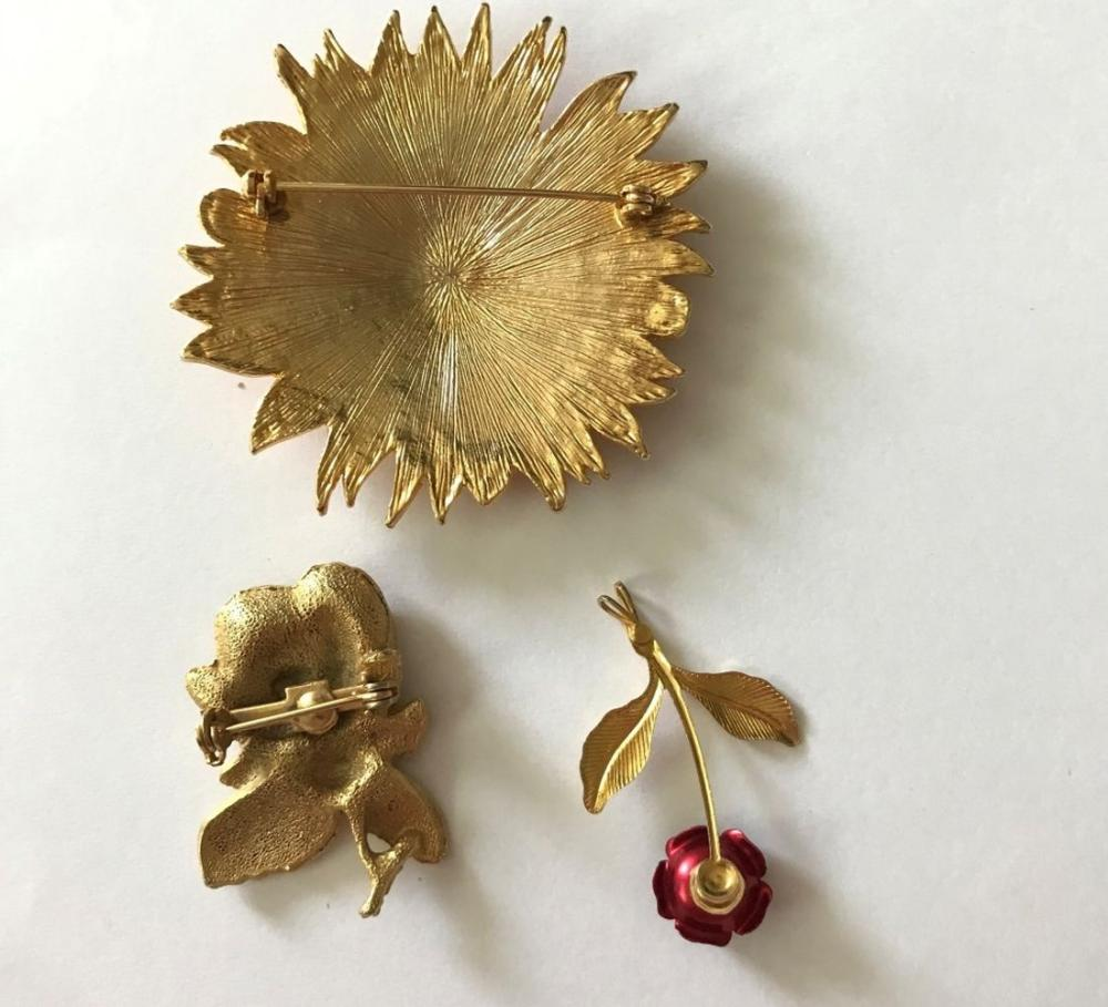 3 FLOWER BROOCHES (1-LARGE)