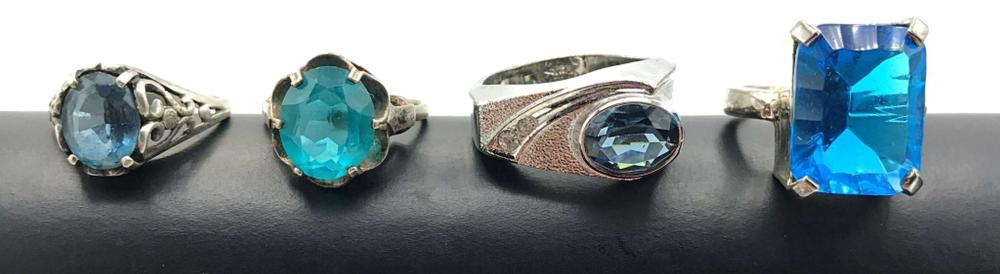 4 STERLING RINGS WITH LARGE BLUE GEMSTONES