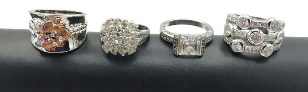 4 EYE CATCHING RINGS W FAKE DIAMONDS
