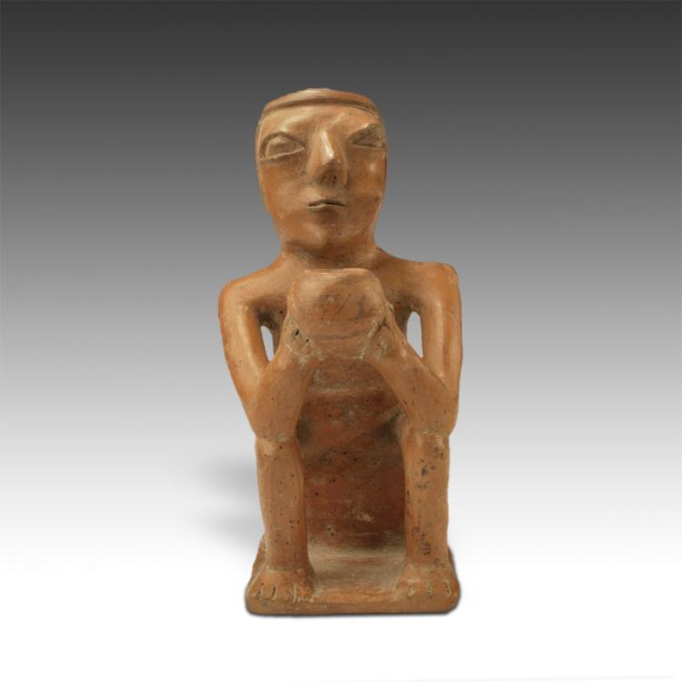 Seated Figure Chewing Coca Leaf