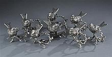 Eight Pewter Bird Napkin Rings