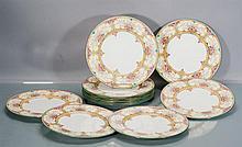 Eleven Wedgwood Enameled Porcelain Dinner Plates