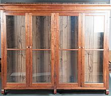 Ca. 1900 Walnut Four Door Glass Book Case