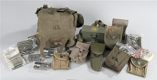 Collection of modern military web gear and 2 WWII M1 carbine clip pouches without clips.