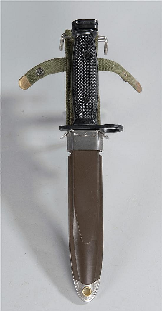 Bayonet for Vietnam-era US Army rifle. A reproduction made in China and so marked on the blade. Complete with scabbard.
