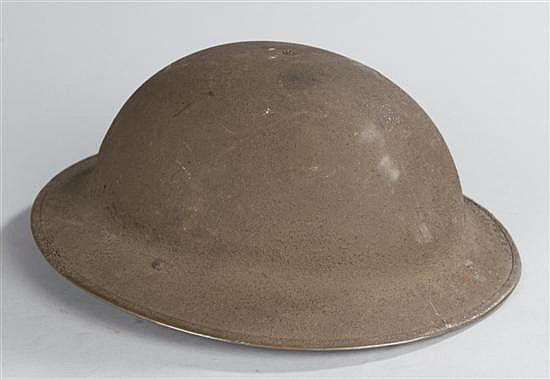 "World War I US Army ""Doughboy's"" helmet, complete with liner and chin strap. Almost mint condition."