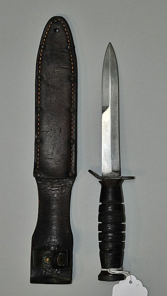 WWII US Army fighting knife with leather grip accompanied by its original leather scabbard