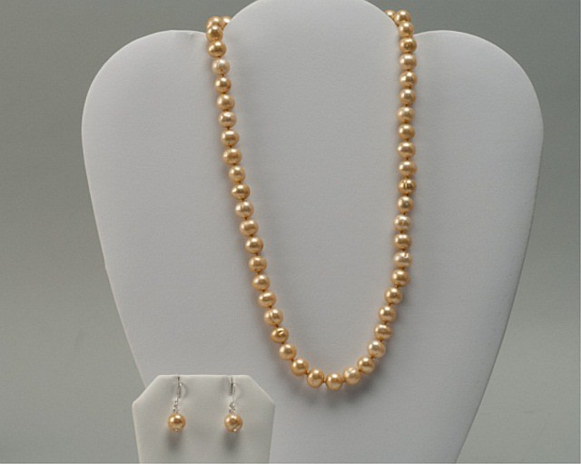 A Champagne Pearl and Sterling Necklace and Earrin