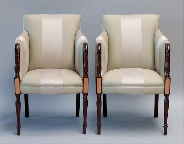 A pair of Hancock & Moore Federal-style armchairs.