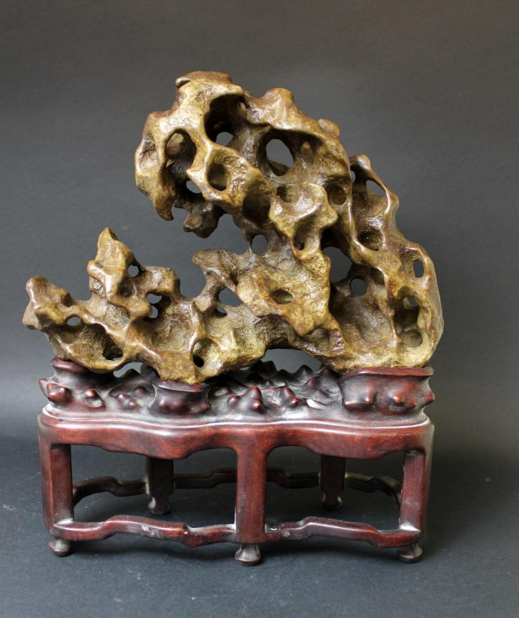 A CHINESE TAI-HU STONE WITH STAND, 19/20TH CENTURY