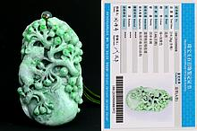A Jadeite Pendant Carving with a Squirrel and Grape