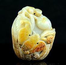 A Chinese Jade Carved Peaches and bats Pendant