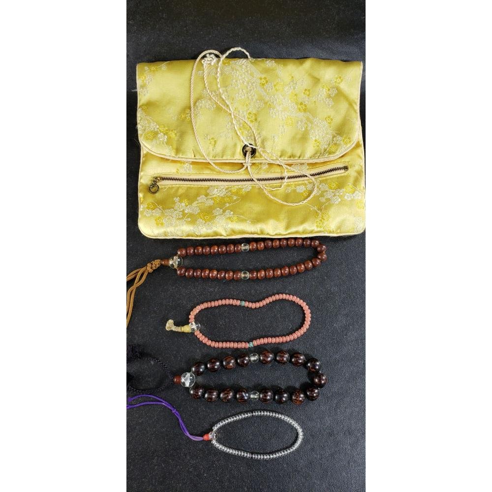 Lot of 4 Chinese string of beads.