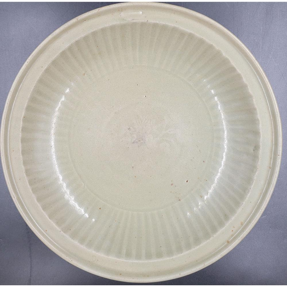 A LARGE EARLY CHINESE CELADON BOWL SONG-MING? DYNASTY