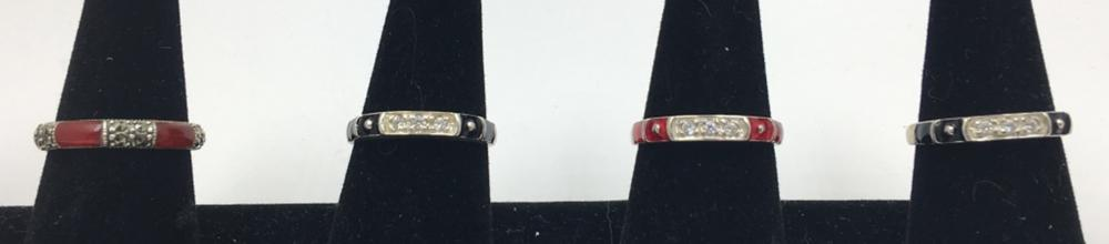 LOT OF FOUR STERLING SILVER AND ENAMEL STACK RINGS