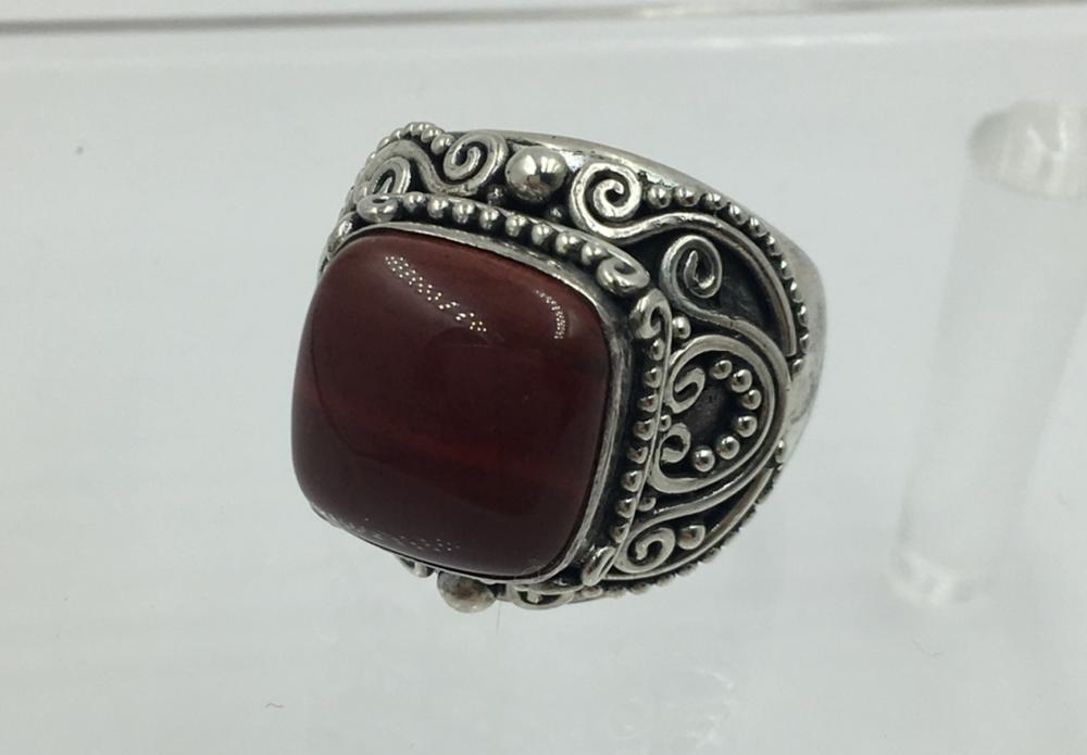 HUGE STERLING SILVER RING WITH DEEP ORANGE STONE