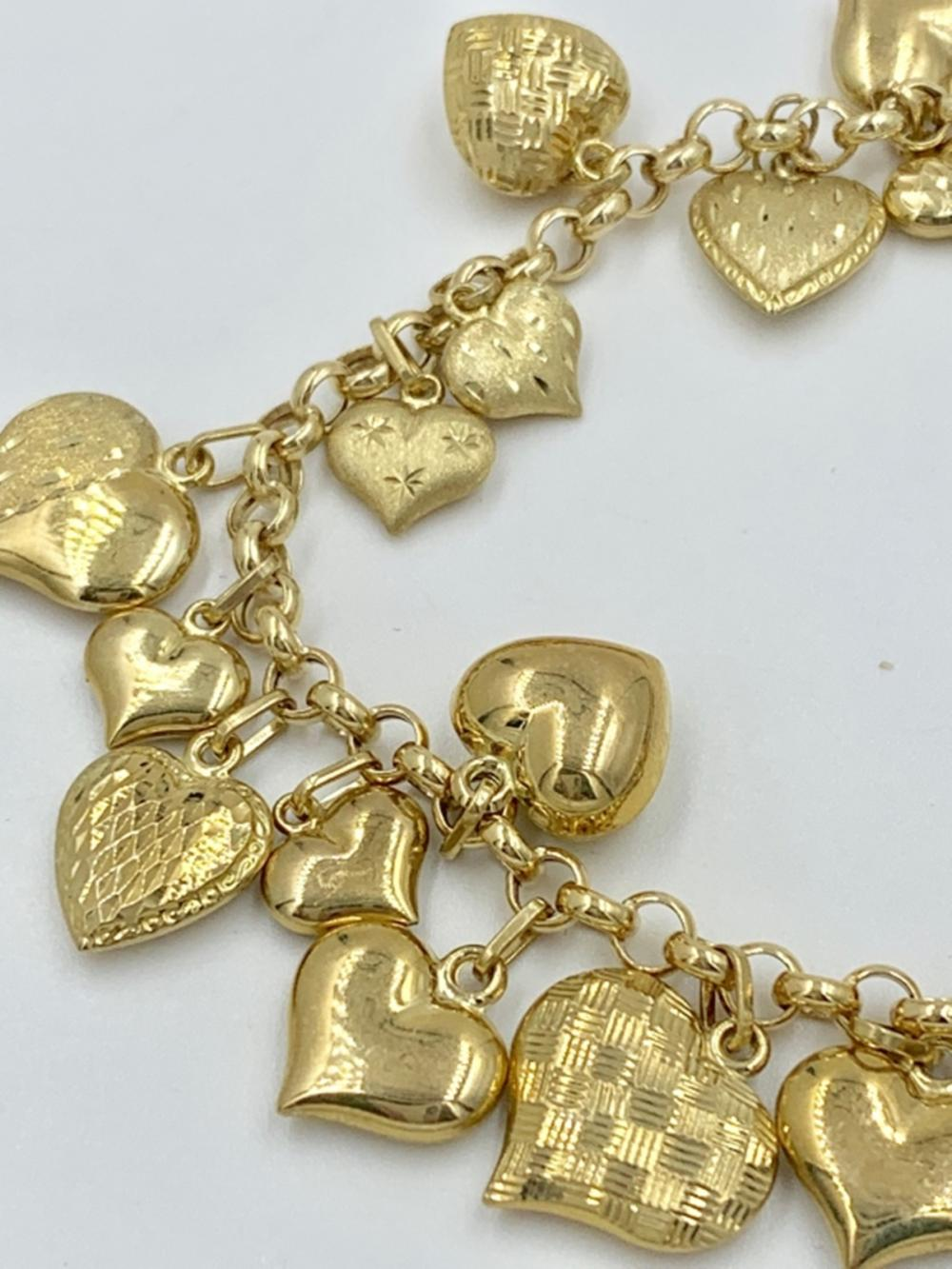 14K CHARM BRACELET WITH HEART CHARMS