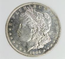 Lot 24: 1904-O MORGAN SILVER DOLLAR