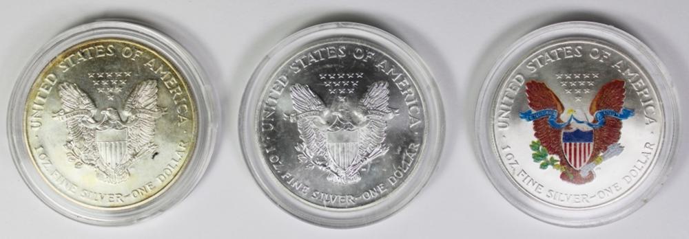 Lot 110: 3 COLORIZED AMERICAN SILVER EAGLES