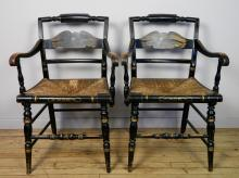 Pair of Hitchcock ebonized and gilt arm chairs