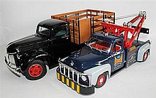 TWO TRUCKS, ROAD LEGENDS '1953 FORD F100 TOW TRUCK' AND A '1940'S FORD FARM TRUCK'. (2)