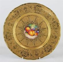 A ROYAL WORCESTER CABINET PLATE, the centre painted with fruit, all over gilt decoration, signed by Alan Telford, date code from 196...