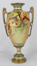 A ROYAL WORCESTER DOUBLE HANDLES VASE, of ovoid form on circular foot, painted with flower on blush ivory ground, date code 1897, sh...