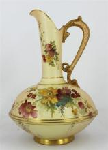 A ROYAL WORCESTER EWER, painted with flowers on a blush ivory ground, heightened in gilt, date code 1886, shape number 1162. Height...