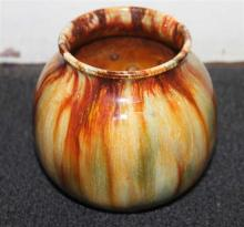 A JOHN CAMPBELL POTTERY VASE, brown drip glaze, signed to base. Height 10.2cm.  bc517/1