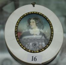 A MINIATURE PORTRAIT IN OVAL IVORY FRAME, depicting