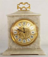 A SWISS BRACKET CLOCK, the agate case on raised feet, gilded dial, retailed by Hardy Brothers. Height 23.5cm.