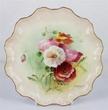 A ROYAL DOULTON PLATE, painted with Poppies on body, with scalloped rim, signed lower right by F.Hodkinson, numbered 72067. Diameter...