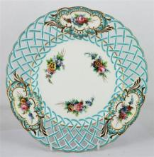 A MINTON PORCELAIN PLATE, with painted flower bouquet decoration and openwork blue rim, heightened in gilt, stamped Minton and numbe...