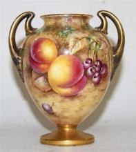 A ROYAL WORCESTER DOUBLE HANDLES VASE, hand painted with fruits, signed P.English, shape number 2701/2. Height 13cm.