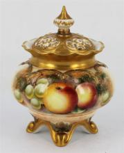 A ROYAL WORCESTER POT POURRIS, of baluster form, painted with fruit, heightened in gilt, signed, date code 1952 and shape number H26...