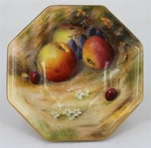 A ROYAL WORCESTER BOWL, of octagonal form, painted with fruits, heightened with gilt, signed William Ricketts, date marks worn, circ...