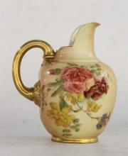 A ROYAL WORCESTER MILK JUG, painted with roses and heightened in gilt on blush ivory ground, date code 1907. Height 11.5cm.